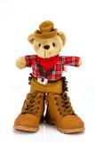 Teddybär- und Stiefelschuhe auf einem weißen Hintergrund Lizenzfreie Stockbilder