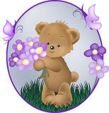Teddybären mit purpurroter Blume Stockfoto