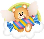 Teddybärengel mit Süßigkeit auf der Wolke Stockbilder