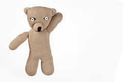 Teddybear. Handmade teddybear with buttoneyes with hand up Royalty Free Stock Photos