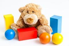 Teddybear and bricks. A teddybear and wooden bricks isolated on white Stock Image