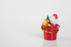 Teddybear in bucket. Teddybear sitting in a bucket with a christmas present Stock Images