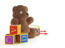 Teddybear, building blocks, and drumb. Isolated child toys teddybear, building blocks, and drumb. This image contains a clipping path for exact isolation from Stock Photography
