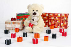 Teddybear with gift boxes with ribbon Stock Image