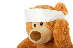 Teddybear with headache Royalty Free Stock Image