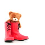 Teddybear in rubber boots Stock Photo
