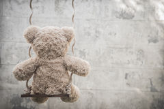 Teddybear on a swing Royalty Free Stock Photos