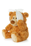 Teddybear with toothache Stock Image