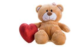 Teddybeer die een hart houdt Stock Foto's