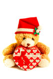 Teddybeer die een santahoed dragen Stock Afbeeldingen