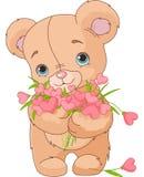 Teddybeer die hartenboeket geven Stock Foto