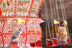 Teddybeer en carrousel Royalty-vrije Stock Foto