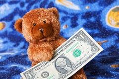 Teddybeer en dollars Royalty-vrije Stock Afbeeldingen