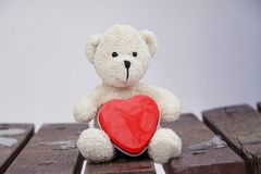 Teddybeer en hart Stock Fotografie
