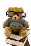 Teddybeer, glazen en stapel van oude boeken Royalty-vrije Stock Foto's