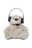 Teddybeer met hoofdtelefoon die over wit wordt geïsoleerdd Royalty-vrije Stock Foto's