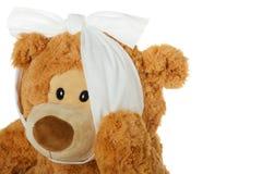Teddybeer met tandpijn Stock Afbeeldingen