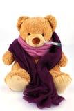 Teddybeer met thermometer Stock Afbeeldingen