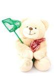 Teddybeer met visserijnet stock afbeelding