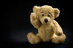 Teddybeer op zwarte achtergrond Stock Afbeelding