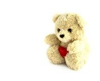 Teddybeerstuk speelgoed met hart Stock Afbeeldingen