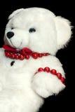 Teddybeerstuk speelgoed op zwarte achtergrond Aanwezig pretkind Stock Afbeelding