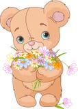 Teddybär, der Blumenstrauß gibt Lizenzfreie Stockfotos