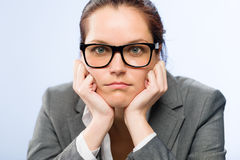 Tedious job woman bored at work. In glasses Stock Photography