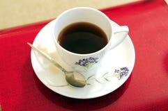 Tee auf Couch Stockbilder