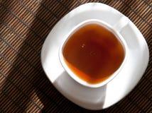 Tee auf einer Schutzkappe Stockbilder