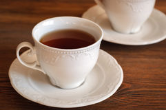 Tee in der eleganten Teetasse Lizenzfreies Stockfoto