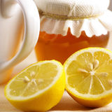 Tee with honey and lemon. Ingredients for a tee with honey and lemon royalty free stock photo