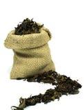Tee im Sack des groben Sackzeugs Stockfotos