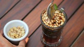 Tee mit Nüssen auf Tunesier stock video footage
