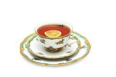 Tee mit Zitrone und Saucers Lizenzfreie Stockfotografie