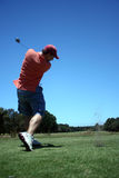 Tee off. A golfer teeing off at the golf course Royalty Free Stock Photography