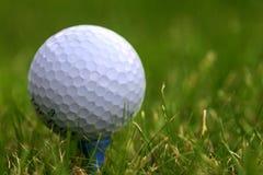 Tee Off. Golf ball on a tee stock photos