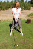 Tee off with cleavage Royalty Free Stock Images