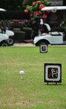 Tee off with golf cart on golf course Royalty Free Stock Images