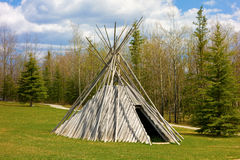 A tee-pee on display at a tourist information center Royalty Free Stock Photos