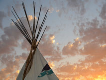 Tee Pee Shelter During Sunset Stock Photo