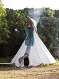 Tee pee (tipi) camp tent. Tee pee (tipi) tent and smoking fire Stock Photo