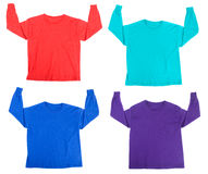 Tee shirts. Bright colored Tee Shirts isolated on white Royalty Free Stock Photography