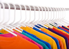 Tee shirts. A lot of bright colored Tee Shirts hanging Royalty Free Stock Photo