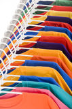 Tee shirts. Bright colored Tee Shirt hanging on a clothesline Royalty Free Stock Photography