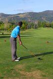 Tee shot. Young male golfer preparing for his tee-shot Stock Images