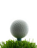 Tee Shot. Golf ball on tee, in the grass stock photo