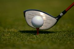 Tee shot. Golf driver about to hit the golf ball Stock Photography