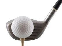 Tee Shot. Golf ball on tee with club behind it, isolated on white Stock Images