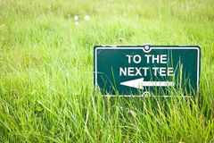 Tee sign. Sign pointing to a tee on a golf course stock photo